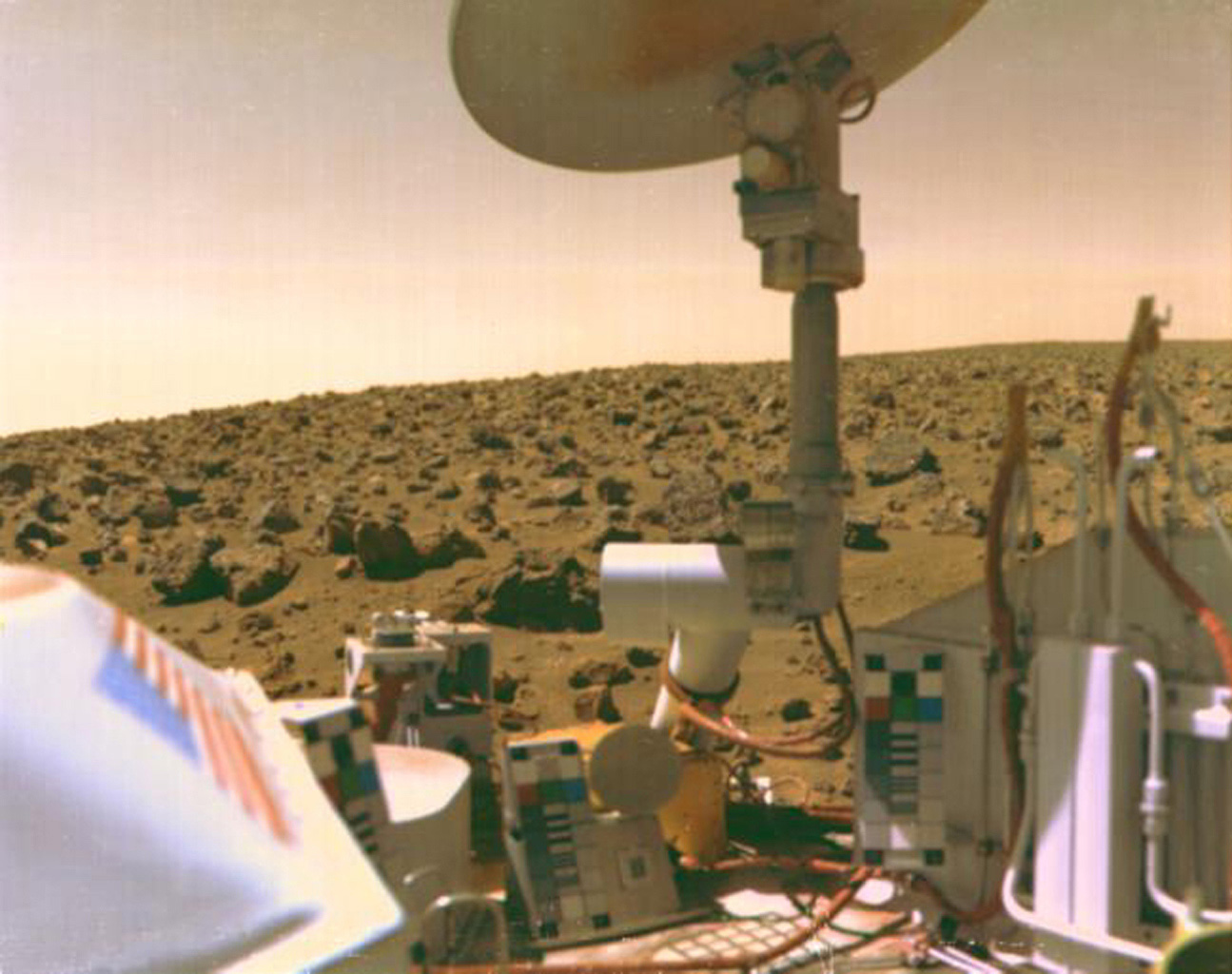 The boulder-strewn field of red rocks reaches to the horizon nearly two miles from NASA's Viking 2 on Mars' Utopian Plain.