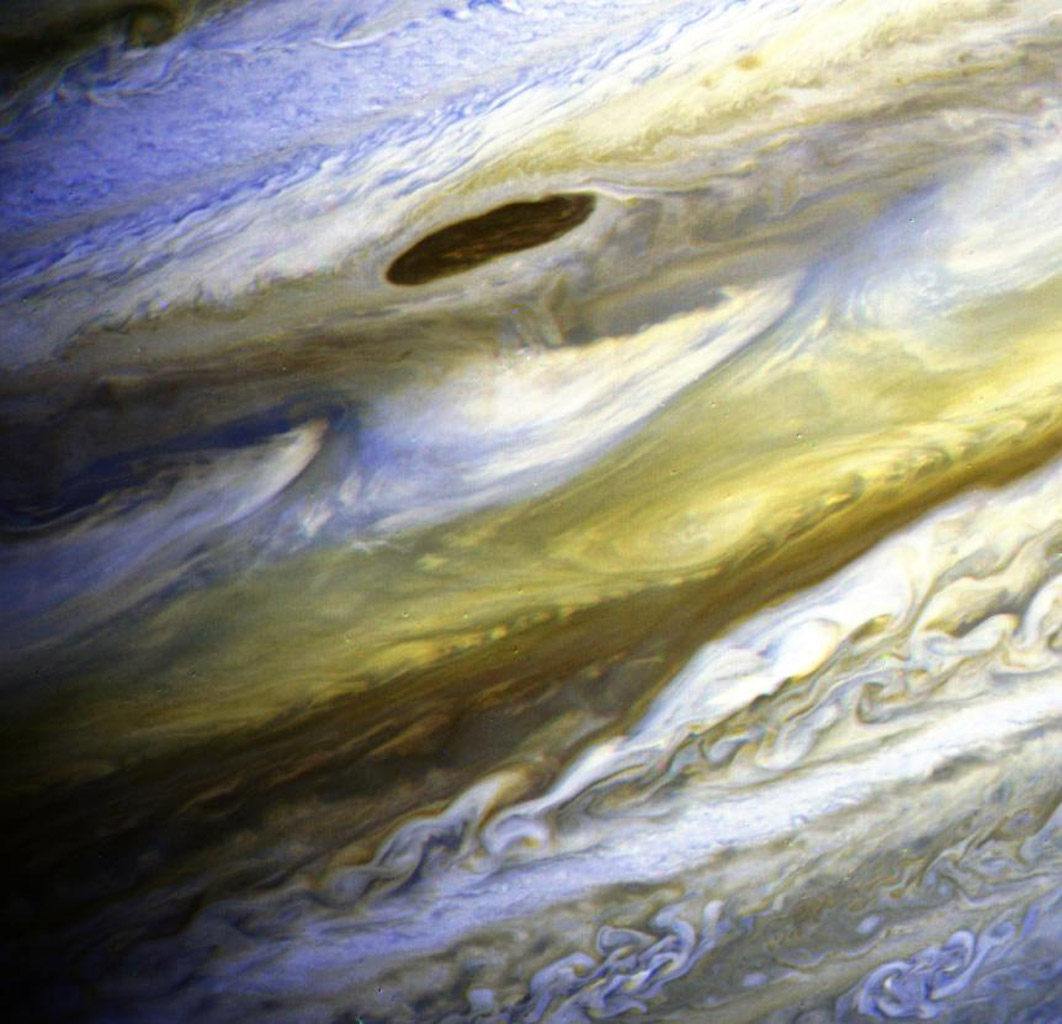 This special color composite made from NASA's Voyager 2 taken on June 28, 1979, has been processed to exaggerate color differences within the naturally colorful Jovian atmosphere. Such processing makes detailed structure in the clouds more apparent.