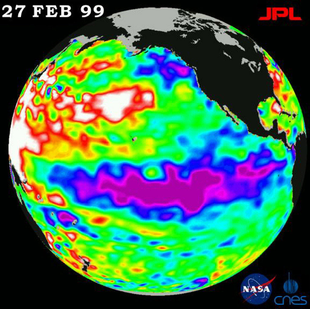 The cold pool of water in the Pacific known as La Niña is seen by data from NASA's U.S.-French TOPEX/Poseidon satellite. Very large, unusual area of higher or warmer water (shown here in red and white) appear in the western Pacific Ocean.