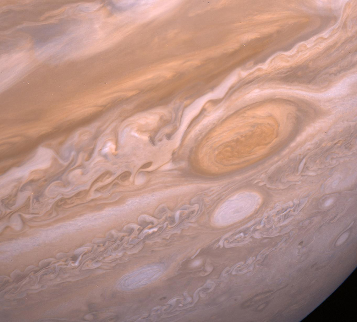 This image from NASA's Voyager 2 shows the region of Jupiter extending from the equator to the southern polar latitudes in the neighborhood of the Great Red Spot.