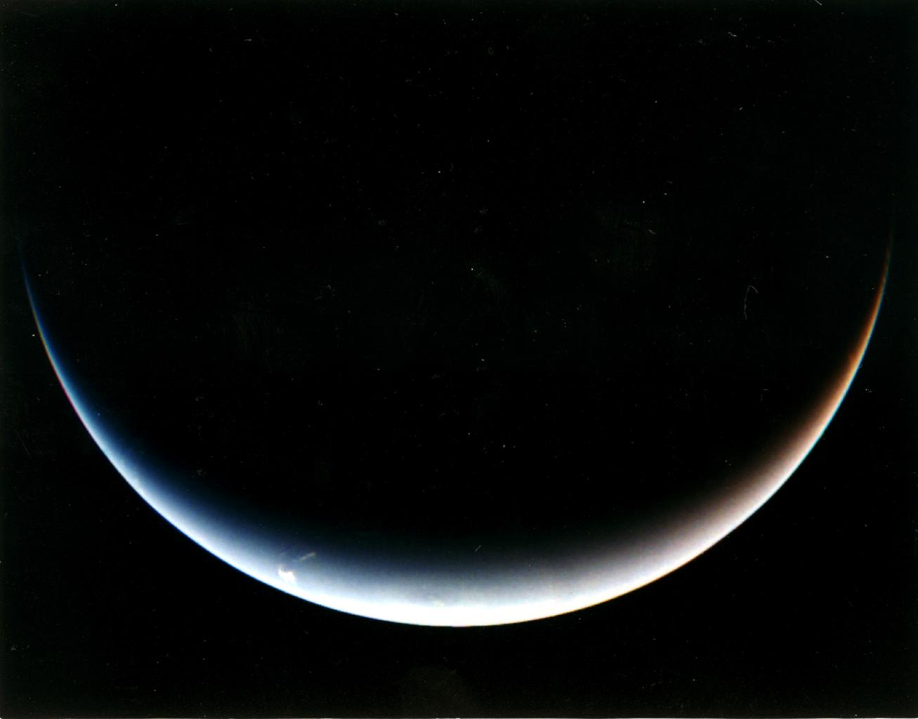 NASA's Voyager 2's post-encounter view of Neptune's south pole as the spacecraft sped away on a southward trajectory.