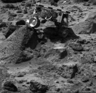 Sojourner's left rear wheel is perched on the rock 'Wedge' in this image, taken on Sol 47 by the Imager for NASA's Mars Pathfinder (IMP).