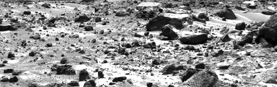 This right image of a stereo image pair taken on the afternoon of Sol 74 (September 17) shows NASA's Sojourner rover behind the rock 'Chimp.' Sojourner is now a record 12.3 m from the lander. Sol 1 began on July 4, 1997.