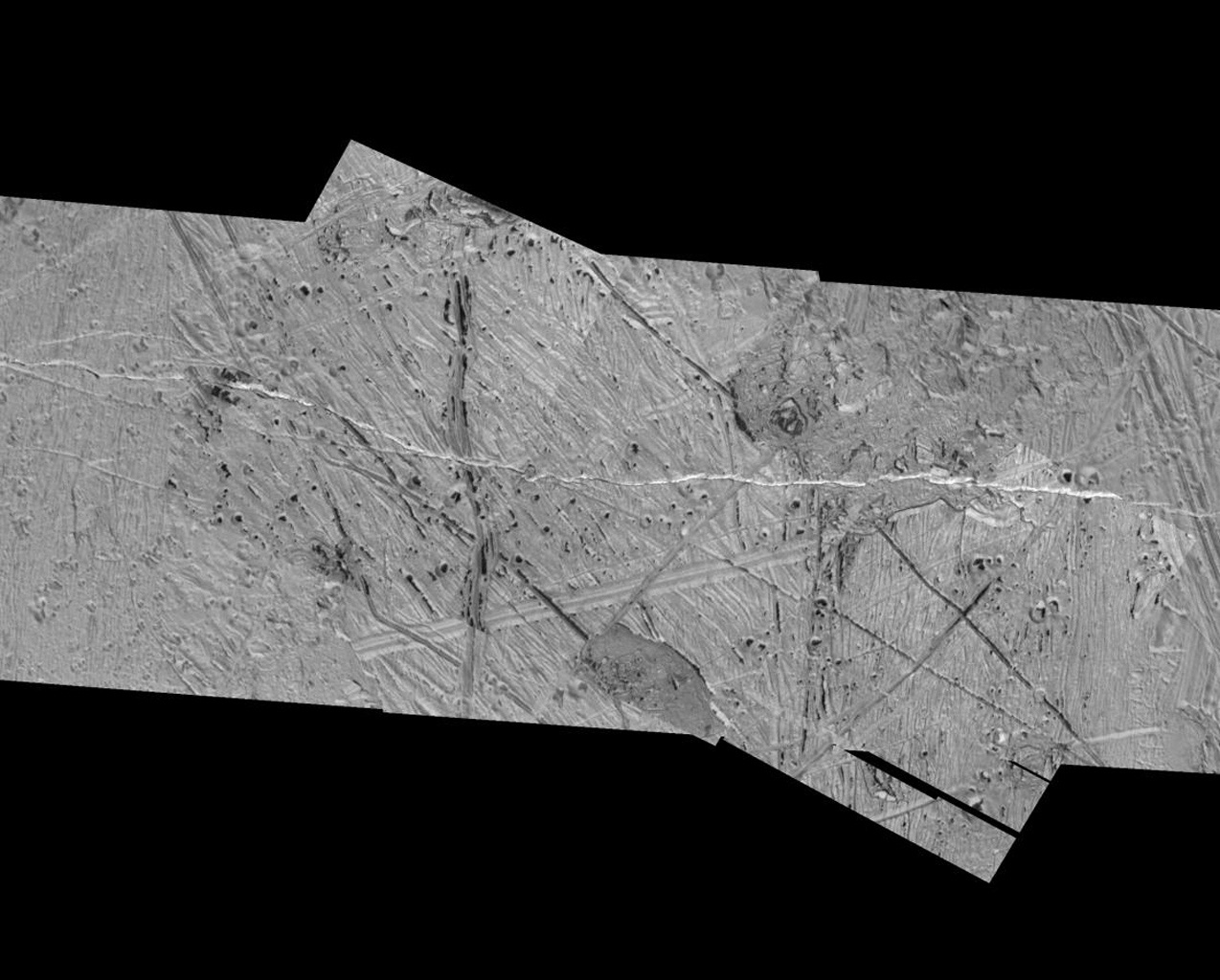 This mosaic of an area just southeast of the Tyre multi-ring structure on Jupiter's moon Europa combines two sets of images taken by NASA's Galileo spacecraft. Features in this area include pits, plains, and regions of chaotic terrain.