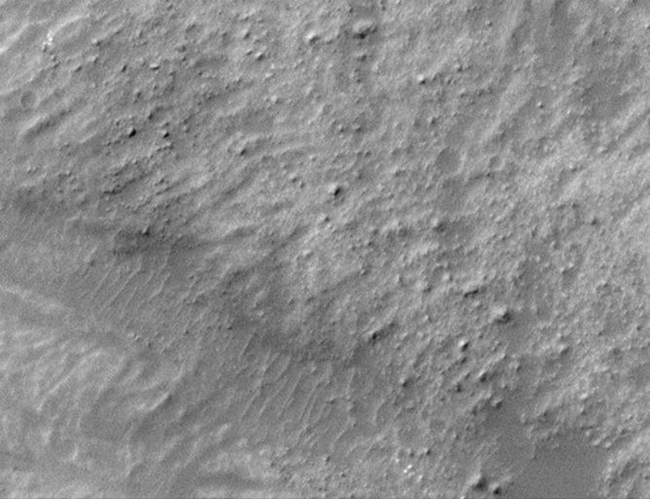 This image from NASA's Mars Global Surveyor shows a field of boulders on the surface of a landslide deposit in Ganges Chasma. Ganges Chasma is one of the valleys in the Valles Marineris canyon system on Mars.