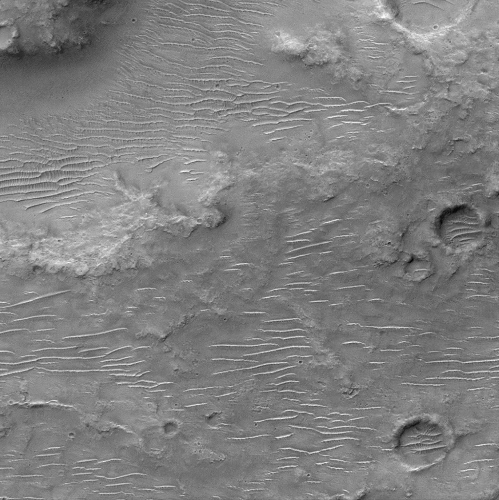 NASA's Mars Global Surveyor shows the cratered uplands located between the Amenthes Fossae and Hesperia Planum with windblown dunes and ripples.