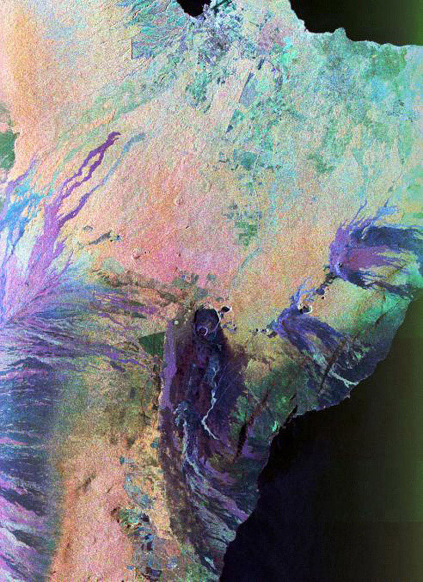 This color composite C-band and L-band image of the Kilauea volcano on the Big Island of Hawaii was acquired by NASA's Spaceborne Imaging Radar-C/X-band Synthetic Aperture Radar flying on space shuttle Endeavour.