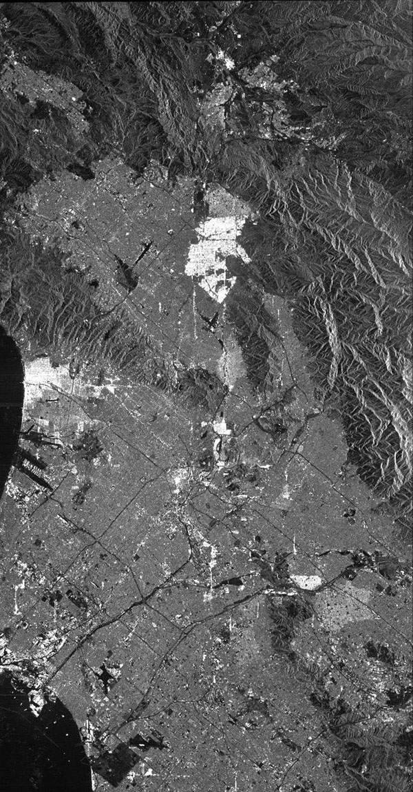 This is a radar image from NASA's Spaceborne Imaging Radar C/X-Band Synthetic Aperture Radar of Los Angeles, CA, taken on October 2, 1994. Visible are the Long Beach Harbor, Los Angeles International Airport, with Santa Monica, and the Hollywood Hills.