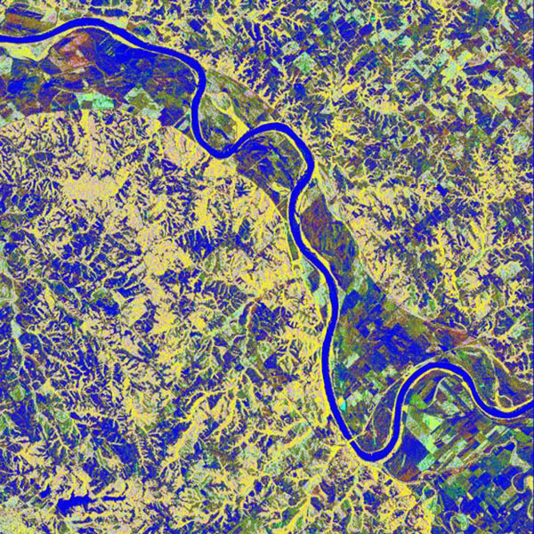 This is a false-color L-band image from NASA's Spaceborne Imaging Radar C/X-Band Synthetic Aperture Radar showing a levee break near Glasgow, Missouri, centered at about 39.2 degrees north latitude and 92.8 degrees west longitude.