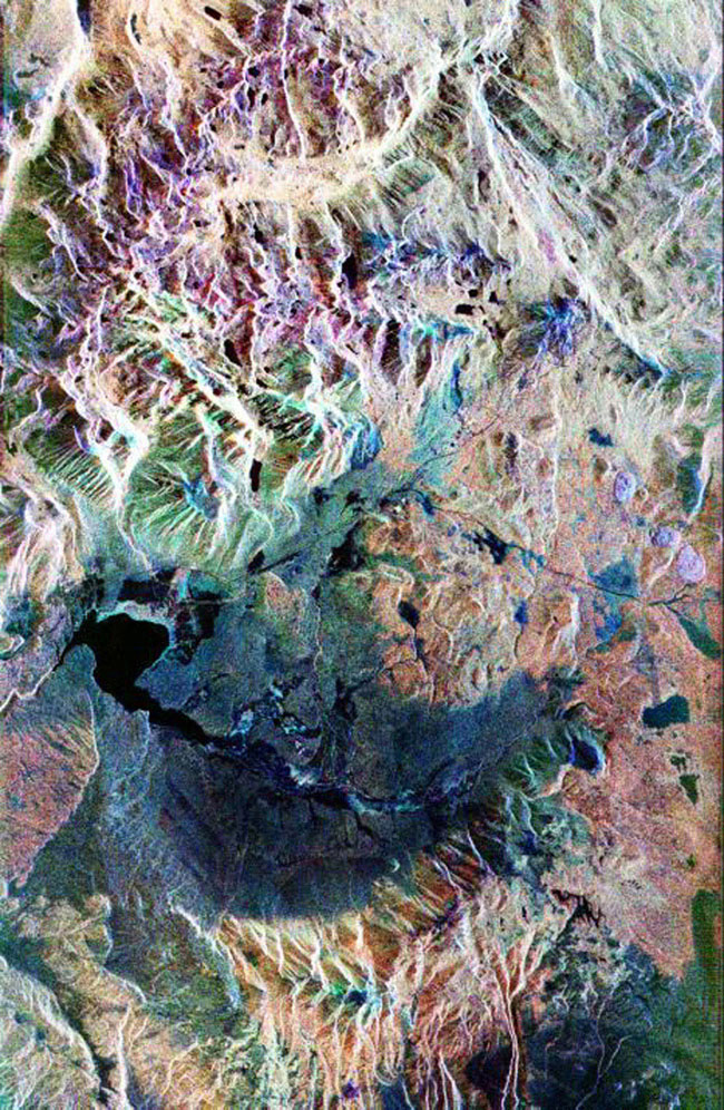 This false-color composite radar image of the Mammoth Mountain area in the Sierra Nevada Mountains, California, was acquired by NASA's Spaceborne Imaging Radar-C and X-band Synthetic Aperture Radar aboard the space shuttle Endeavour.