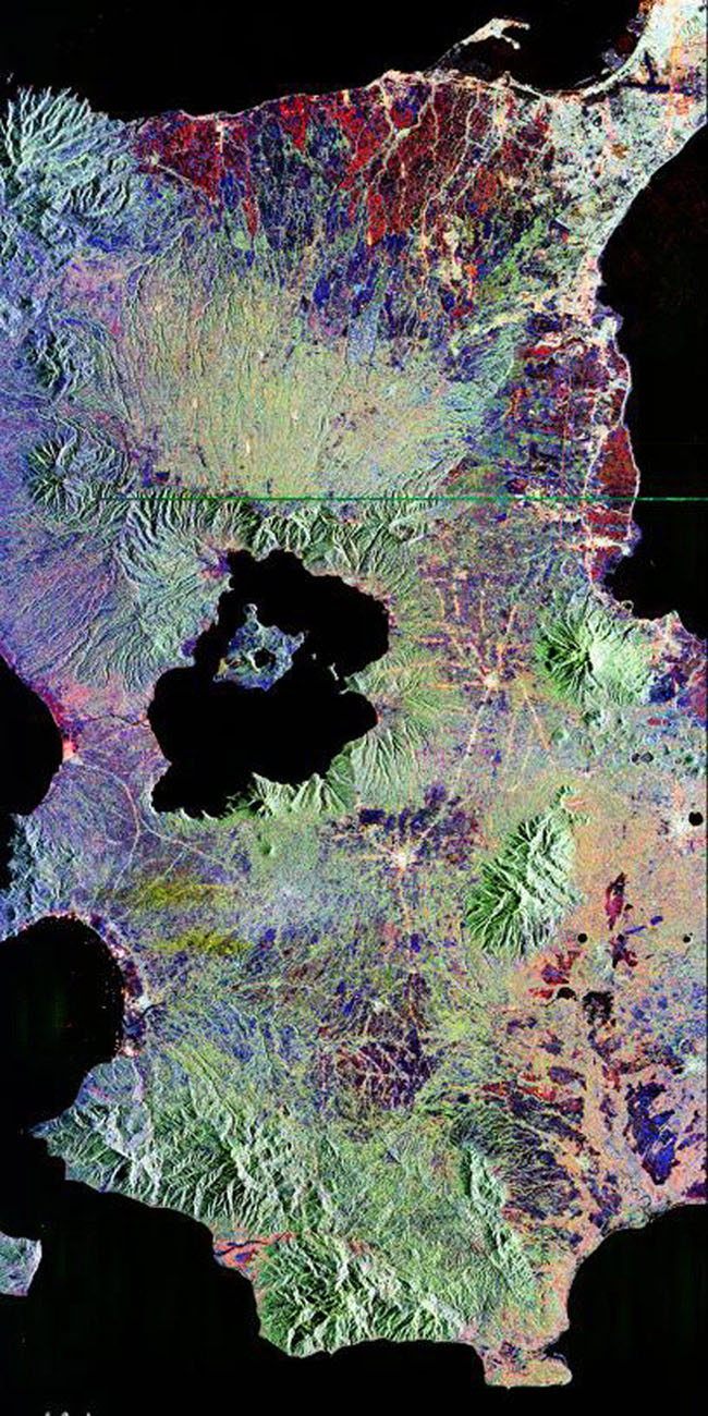This is an image NASA's Spaceborne Imaging Radar-C/X-band Synthetic Aperture of Taal volcano, near Manila on the island of Luzon in the Philippines. The black area in the center is Taal Lake, which nearly fills the 30-kilometer-diameter (18-mile) caldera.