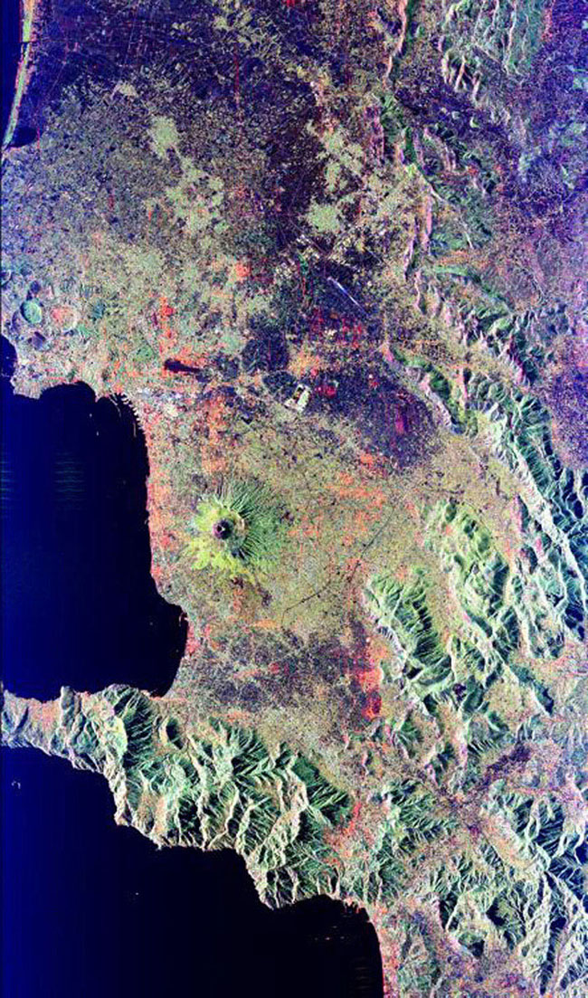 Mt. Vesuvius, one of the best known volcanoes in the world primarily for the eruption that buried the Roman city of Pompeii, is shown in the center of this radar image from NASA's Spaceborne Imaging Radar-C/X-band Synthetic Aperture Radar.