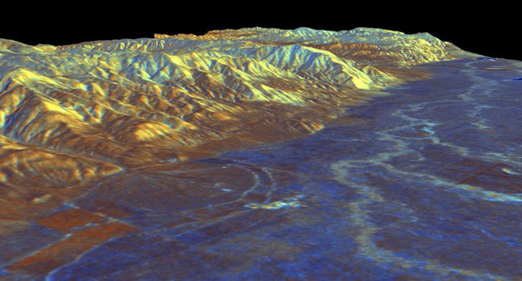 This is a three-dimensional perspective view from NASA's Spaceborne Imaging Radar C/X-Band Synthetic Aperture Radar of Owens Valley, near the town of Bishop, California.