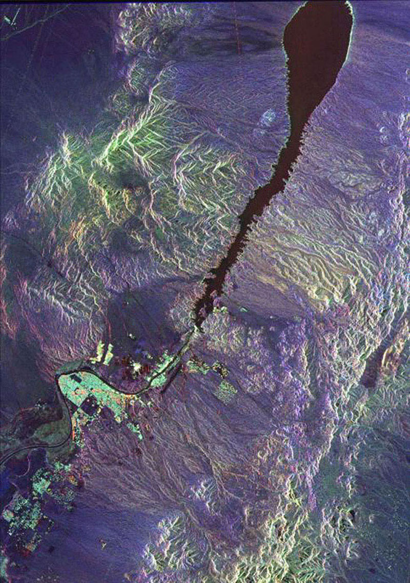 This space radar image from NASA's Spaceborne Imaging Radar-C/X-band Synthetic Aperture shows urban development along the lower Colorado River at the Nevada/Arizona state line. Lake Mojave is the dark feature that occupies the river valley.