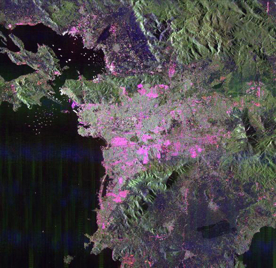 This space radar image from NASA's Spaceborne Imaging Radar-C/X-band Synthetic Aperture of Athens, Greece, shows the sprawling, modern development of this ancient capital city. Densely populated urban areas appear in shades of pink and light green.