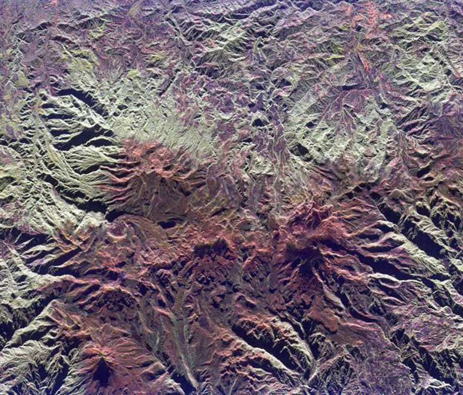 This spaceborne radar image from NASA's Spaceborne Imaging Radar C/X-Band Synthetic Aperture Radar shows the Ruiz-Tolima volcanic region in central Colombia, west of Bogata. The town of Manizales, Colombia, is the pinkish area.