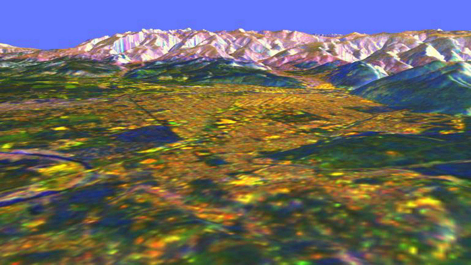 This is a three-dimensional perspective view from NASA's Spaceborne Imaging Radar C/X-Band Synthetic Aperture Radar of Missoula, Montana, created by combining using a technique known as interferometry.