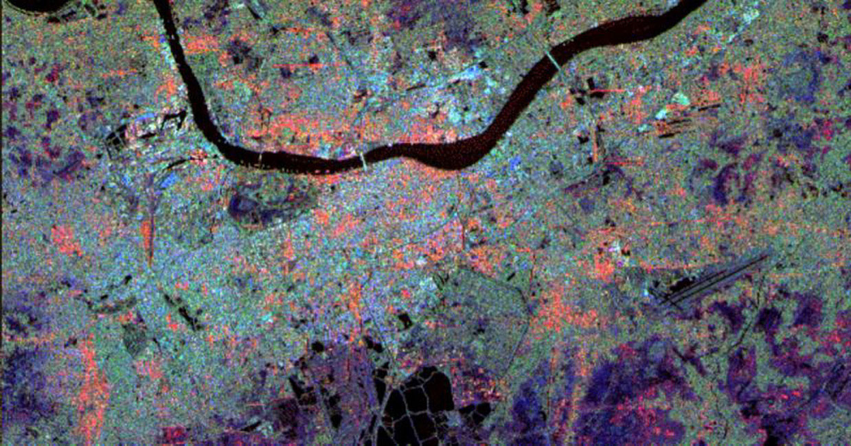 This radar image from NASA's Spaceborne Imaging Radar-C/X-band Synthetic Aperture of Calcutta, India, illustrates different urban land use patterns; it is the largest city in India, located on the banks of the Hugli River, shown as the thick, dark line.