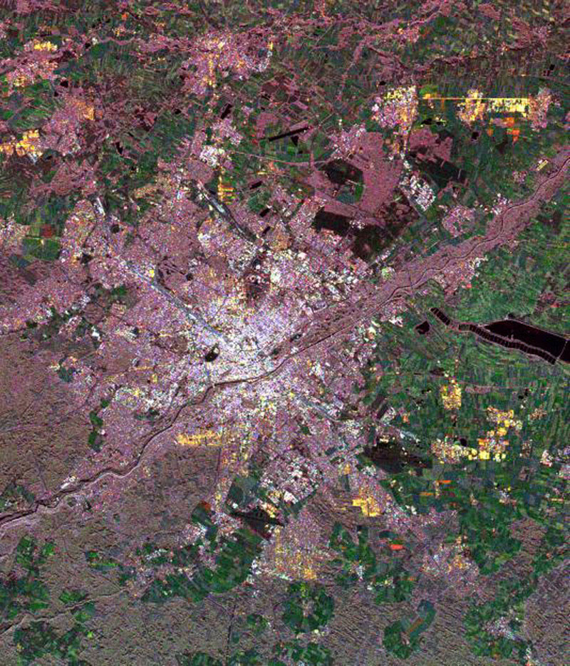This spaceborne radar image from NASA's Spaceborne Imaging Radar C/X-Band Synthetic Aperture Radar of Munich, Germany highlights different land use patterns in the area surrounding Bavaria's largest city.