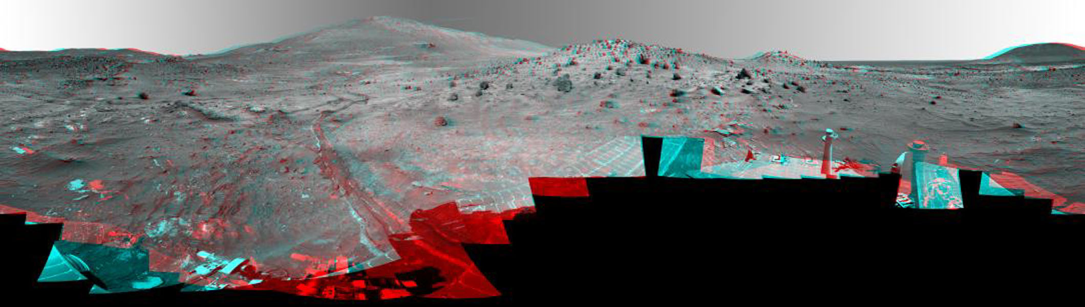 This 360-degree view, called the 'McMurdo' panorama, comes from the panoramic camera aboard NASA's Mars Exploration Rover Spirit. From April through October 2006, Spirit has stayed on a small hill known as 'Low Ridge.' 3D glasses are necessary.