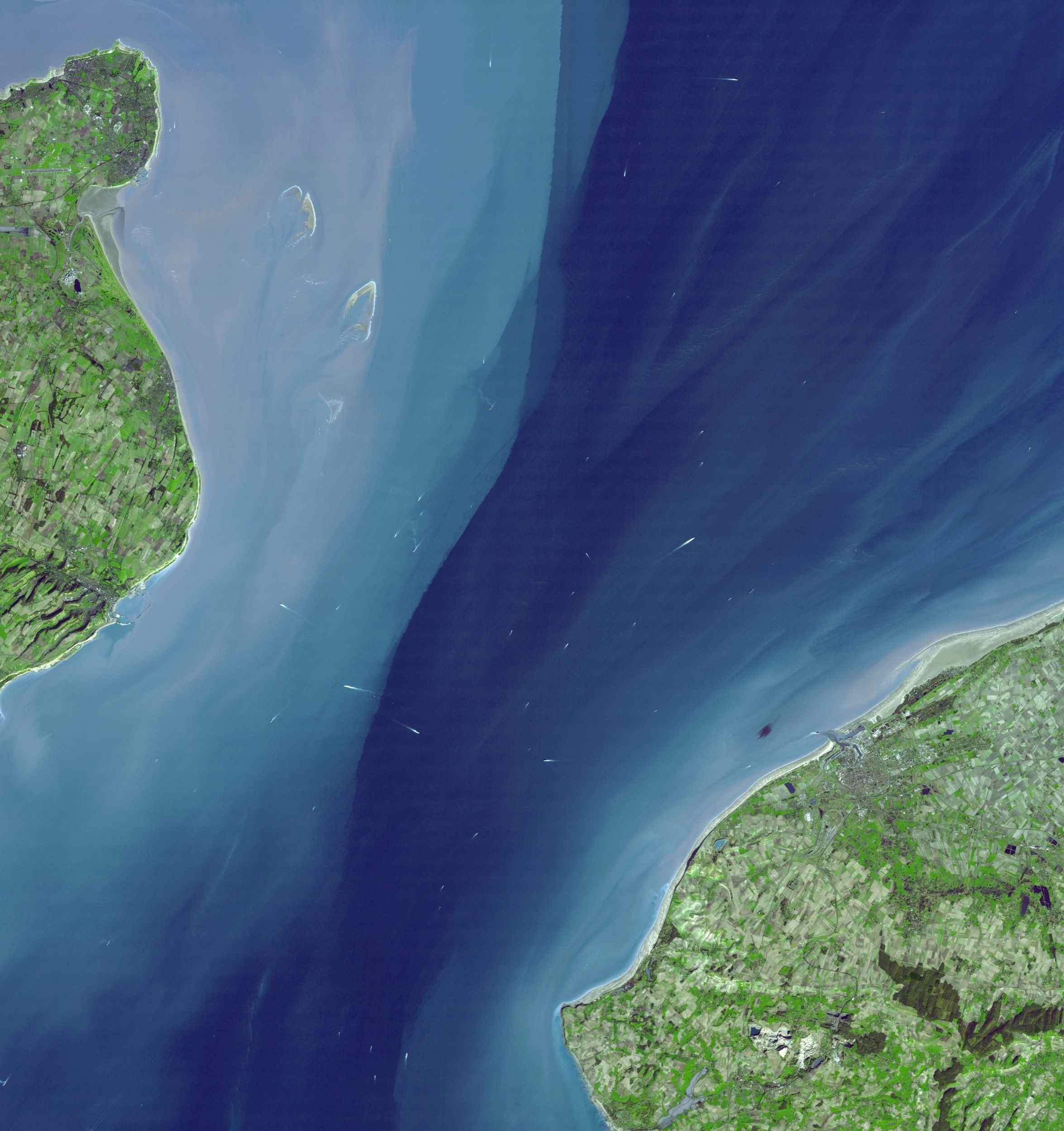 The Channel Tunnel is a 50.5 km-long rail tunnel beneath the English Channel at the Straits of Dover. It connects Dover, Kent in England with Calais, northern France. This image was acquired by NASA's Terra spacecraft.