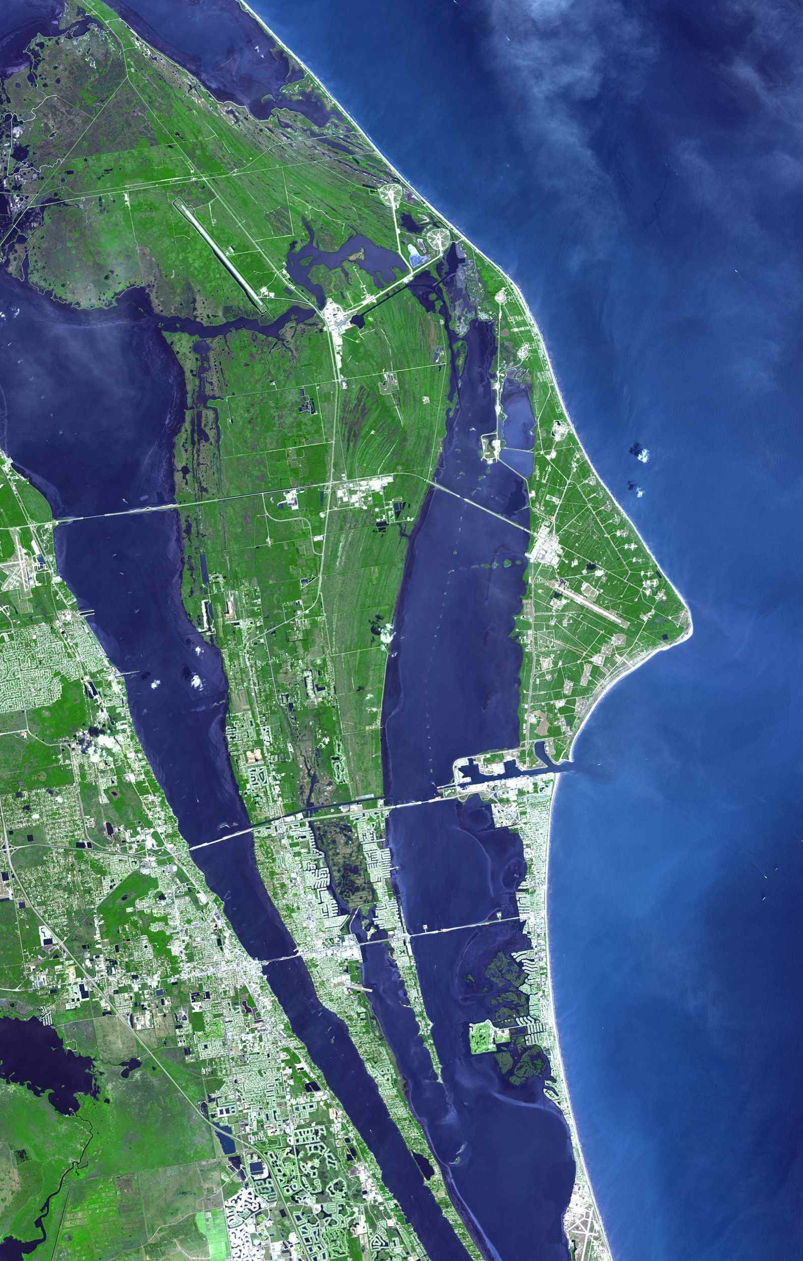 The John F. Kennedy Space Center, America's spaceport, is located along Florida's eastern shore on Cape Canaveral. Established as NASA's Launch Operations Center on July 1, 1962, This image was acquired by NASA's Terra spacecraft.