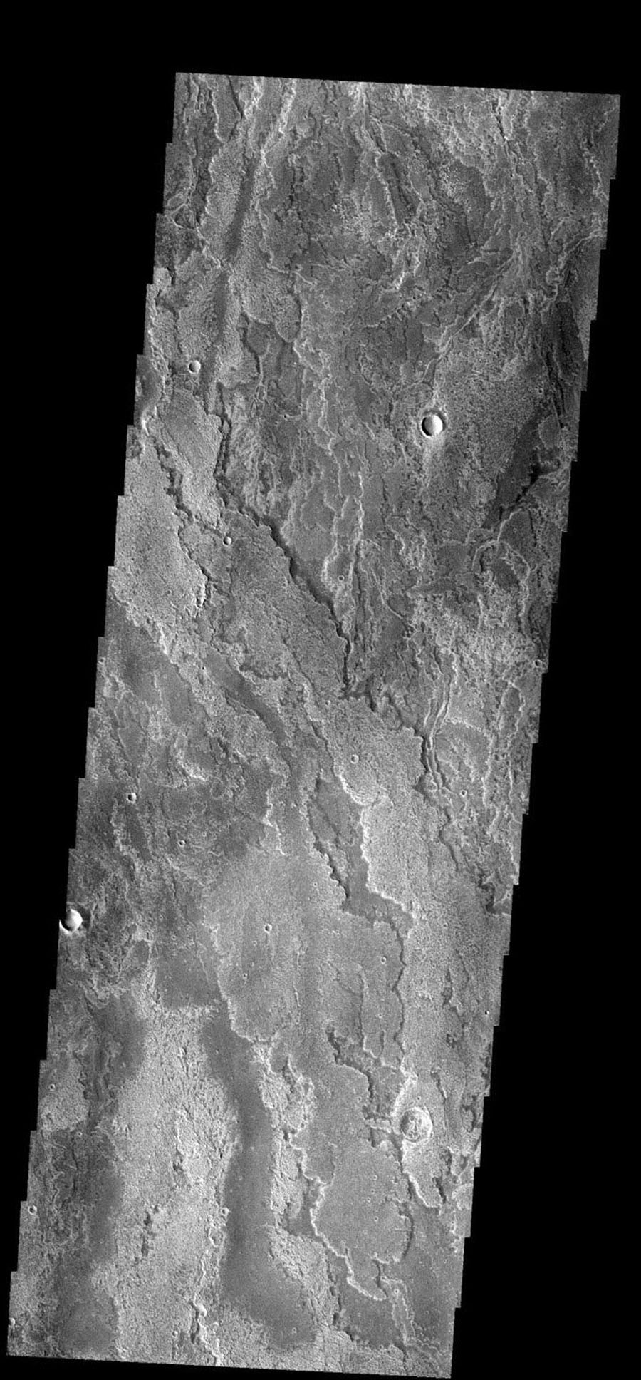These layered volcanic flows originated from Arsia Mons on Mars as seen by NASA's 2001 Mars Odyssey spacecraft.