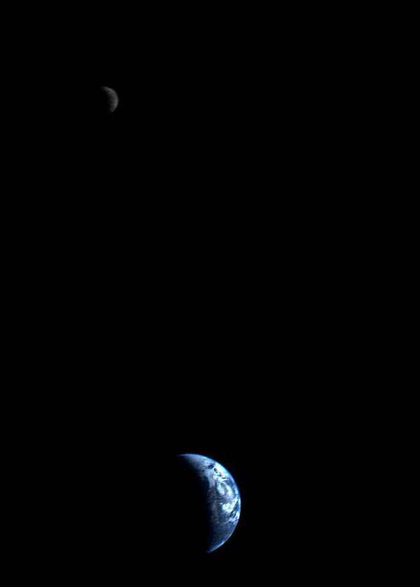 This picture of a crescent-shaped Earth and Moon -- the first of its kind ever taken by a spacecraft -- was recorded Sept. 18, 1977, by NASA's Voyager 1 when it was 7.25 million miles (11.66 million kilometers) from Earth.