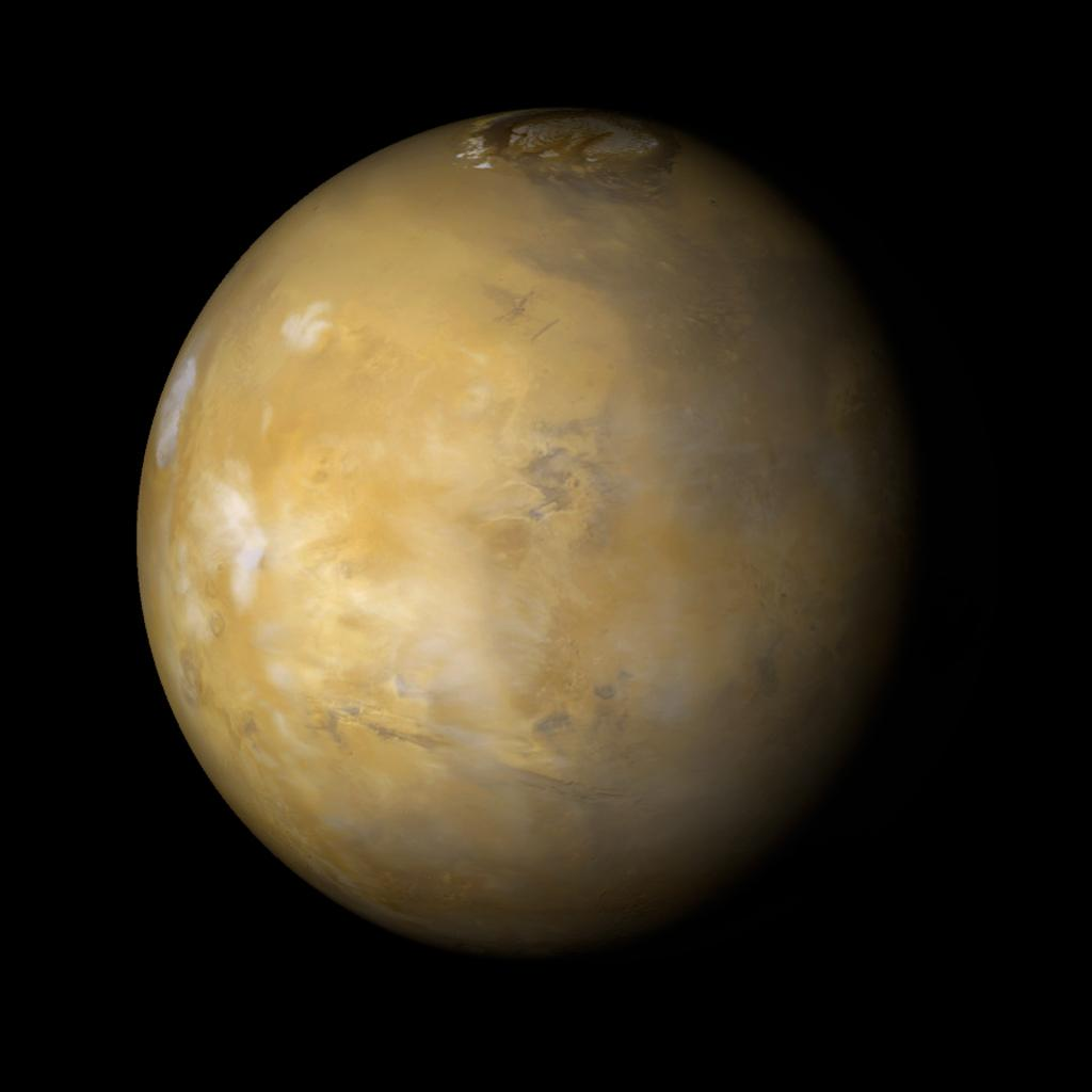 NASA's Mars Global Surveyor shows northern summer on Mars where clouds are very common over the famous Tharsis volcanoes during the afternoon.