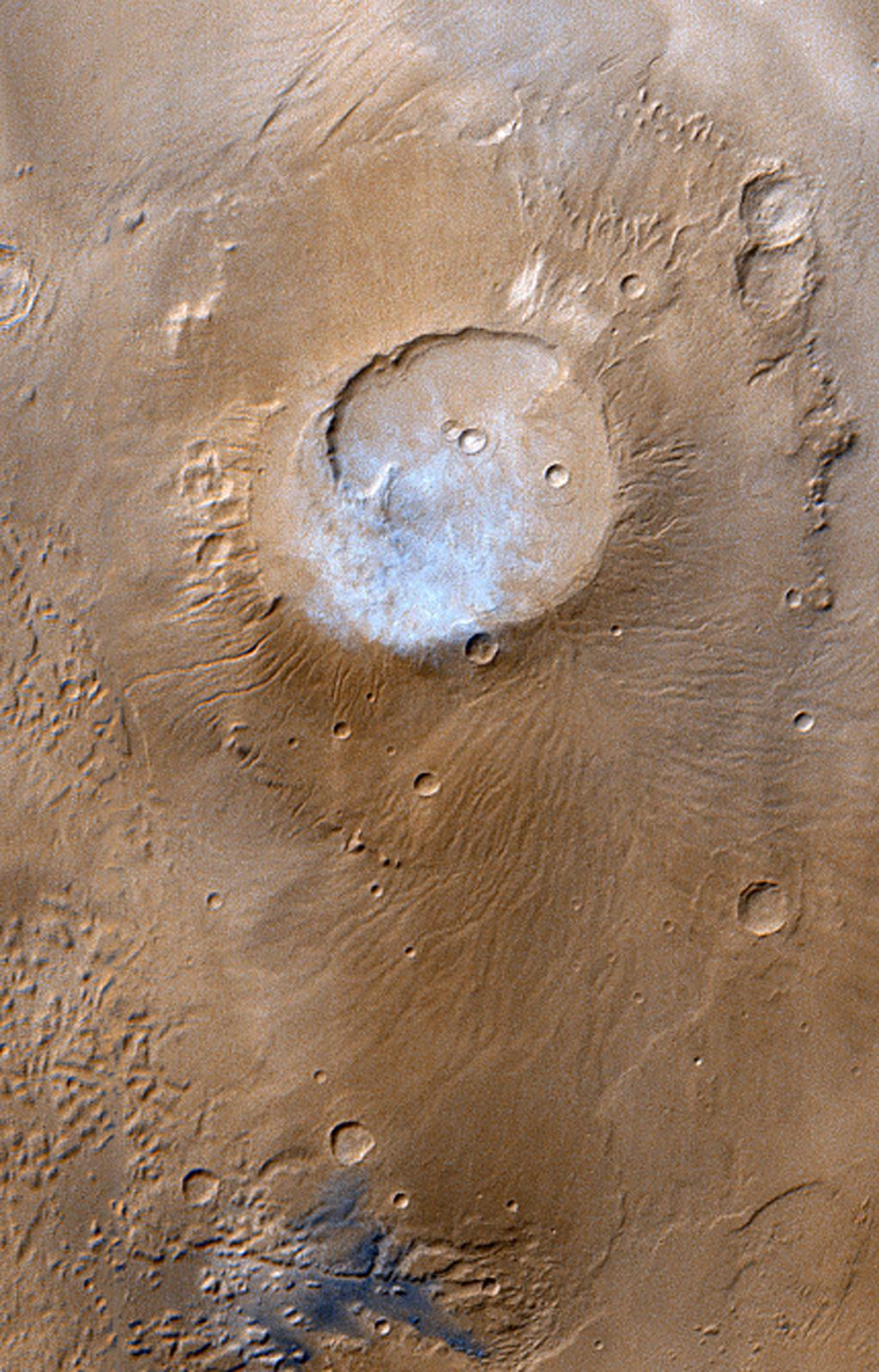 NASA's Mars Global Surveyor passed over the Apollinaris Patera volcano and captured a patch of bright clouds hanging over its summit in the early martian afternoon during the month of April 1999.