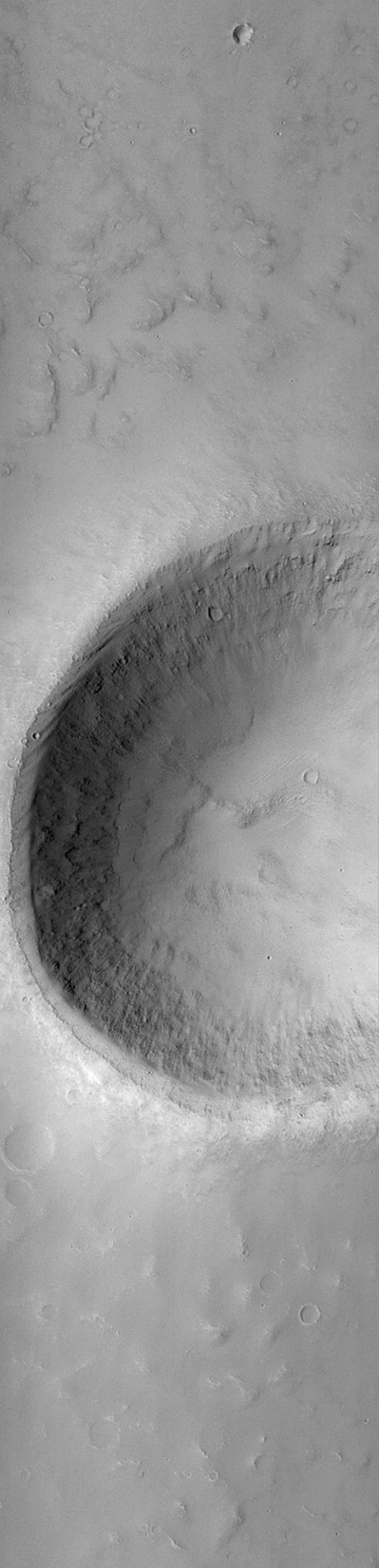 NASA's Mars Global Surveyor shows a crater located on a plain west of the Tartarus Montes (east of Elysium Mons volcano). The crater shows deposits of sand and dust on the floor and in low areas around the rim.