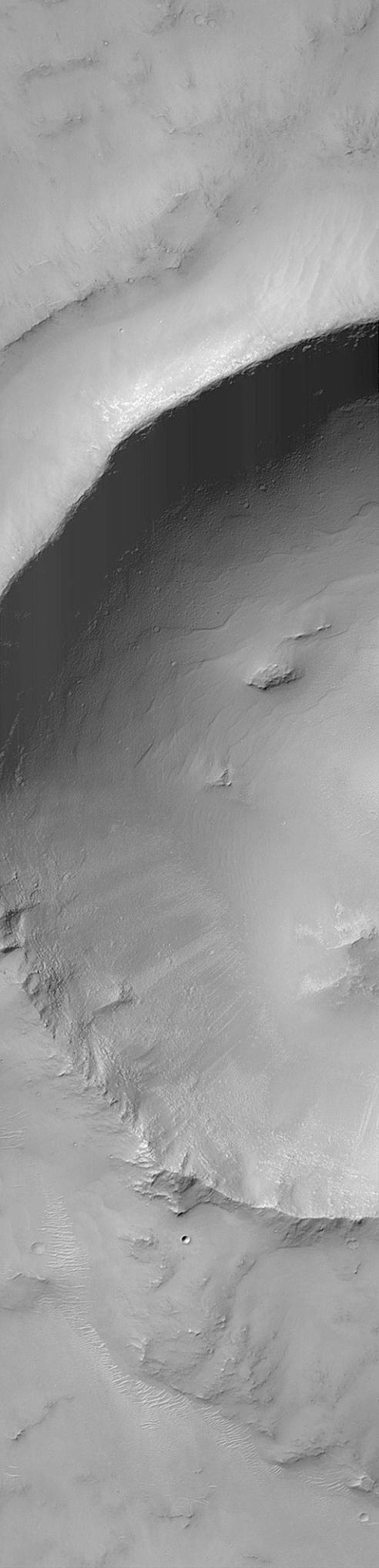 NASA's Mars Global Surveyor shows a crater located in south-central Syria Planum on Mars. This crater was formed by the impact and explosion of a meteorite at some time in the martian past.