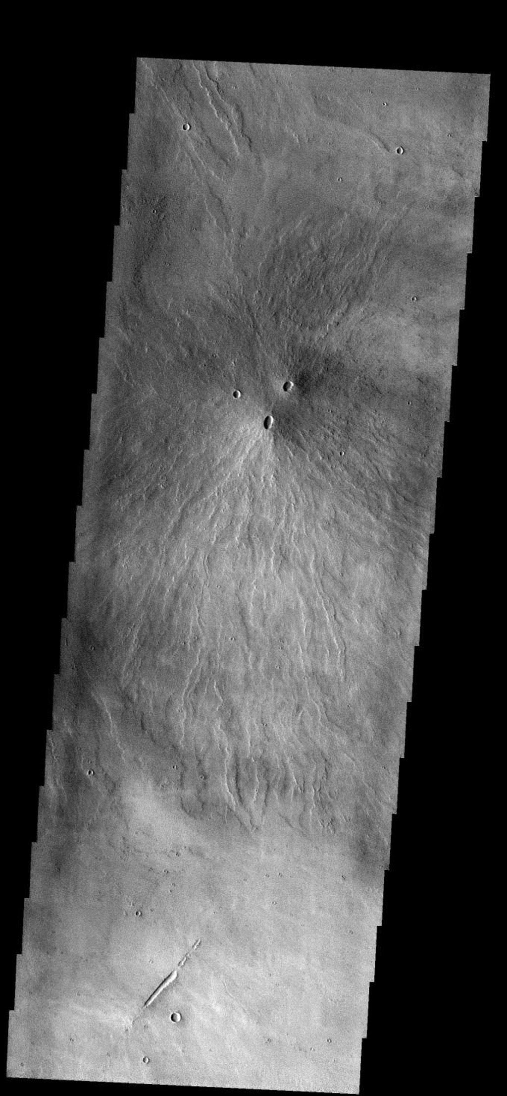 Two volcanic vents have erupted material to form this small volcano just south of Pavonis Mons on Mars as seen by NASA's 2001 Mars Odyssey.