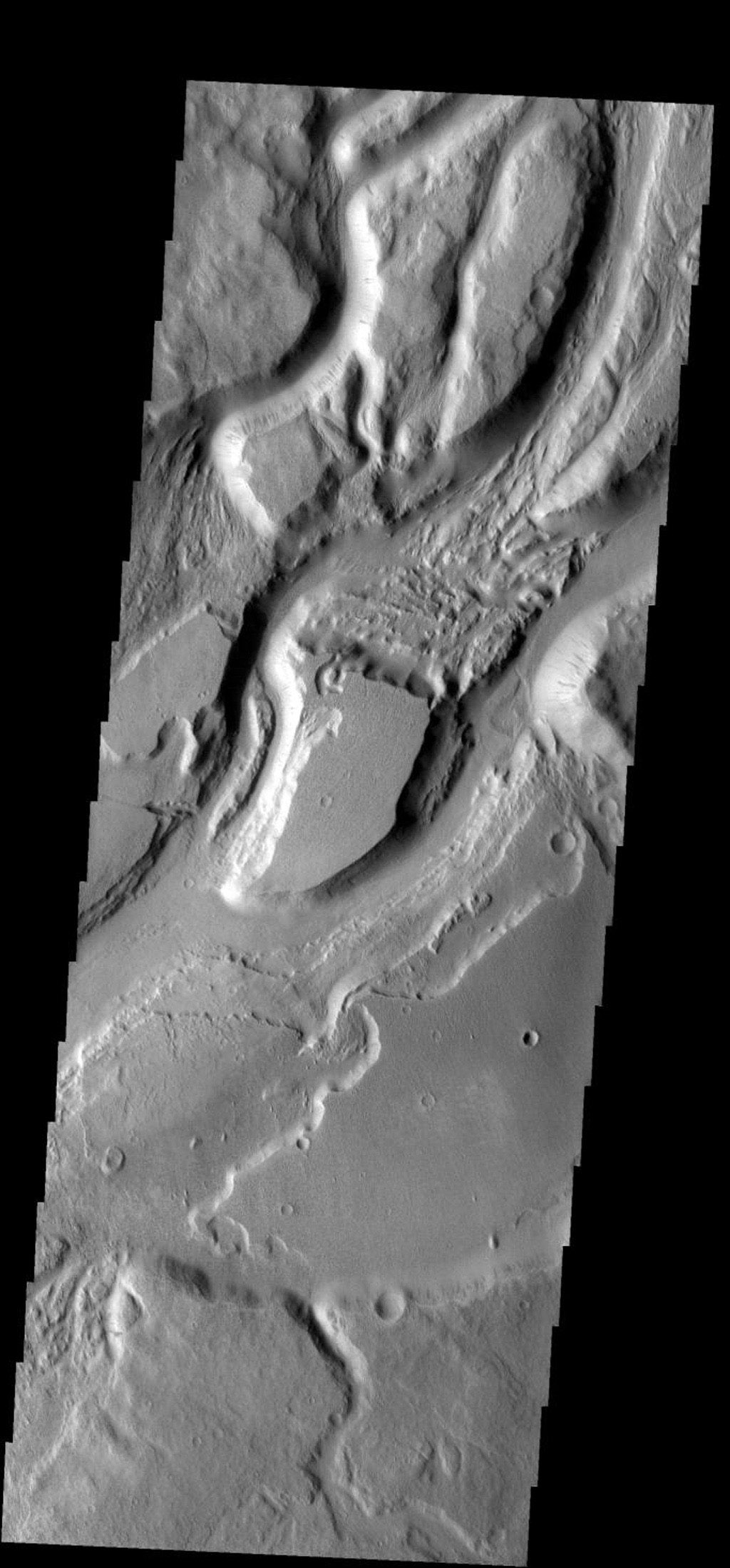 The many interconnected channels in this image are all part of Sabis Vallis on Mars as seen by NASA's 2001 Mars Odyssey spacecraft.