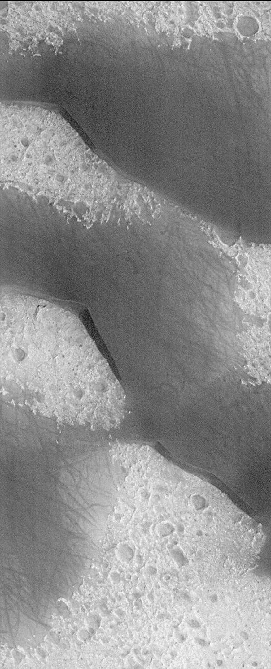 NASA's Mars Global Surveyor shows very large windblown sand dunes of Mars, composed of dark, rather than light grains.