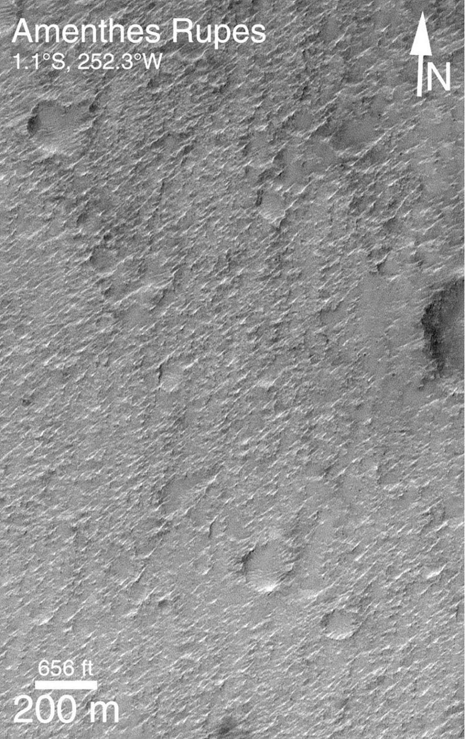 NASA's Mars Global Surveyor shows an area on Mars that appears to be smooth, with rough texture probably cause by wind erosion.