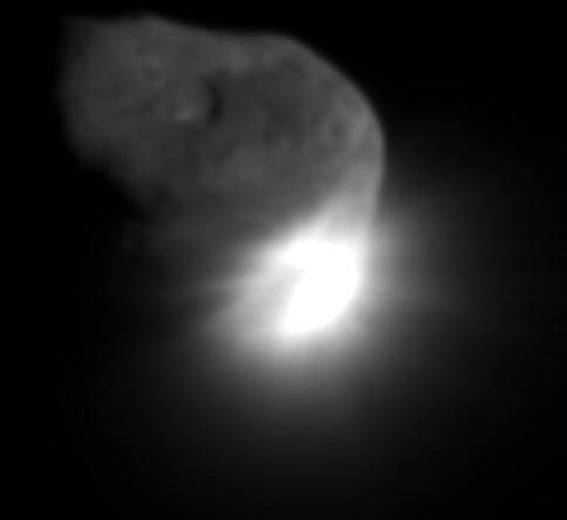 This image shows the initial ejecta that resulted when NASA's Deep Impact probe collided with comet Tempel 1 at 10:52 p.m. Pacific time, July 3 (1:52 a.m. Eastern time, July 4), 2005.