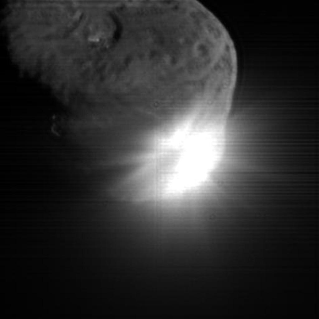 This image shows the initial ejecta that resulted when NASA's Deep Impact probe collided with comet Tempel 1 on July 3, 2005. It was taken by the spacecraft's high-resolution camera 13 seconds after impact.