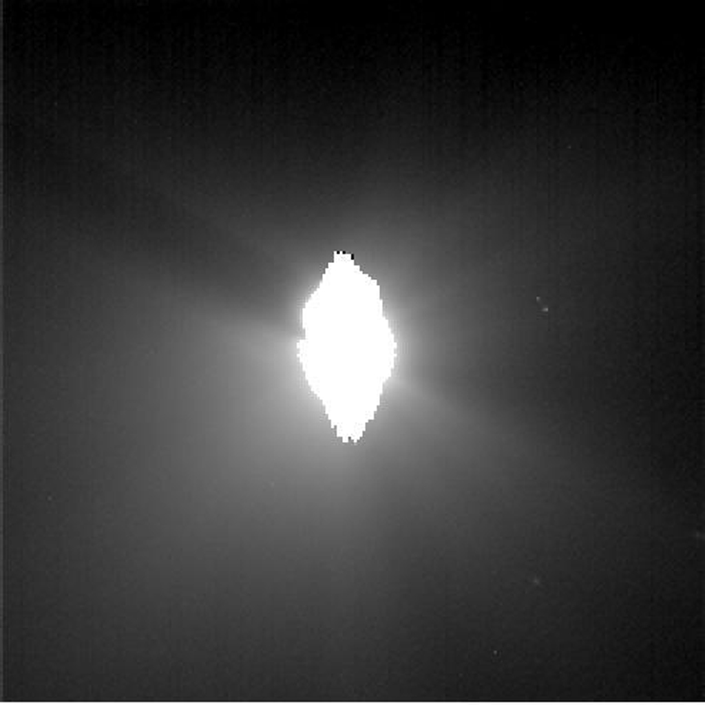 This image shows the view from NASA's Deep Impact's probe 30 minutes before it was pummeled by comet Tempel 1. The picture's brightness has been enhanced to show the jets of dust streaming away from the comet.