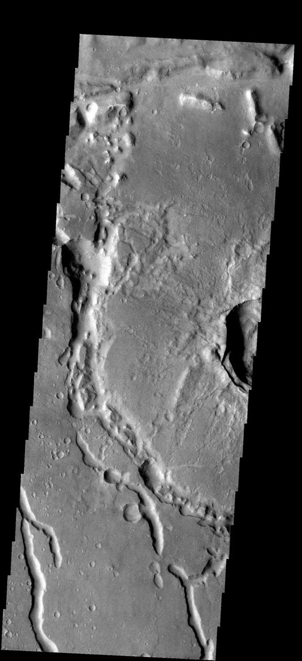 The discontinuous channels in this image are collapsed lava tubes on Mars as seen by NASA's 2001 Mars Odyssey spacecraft.