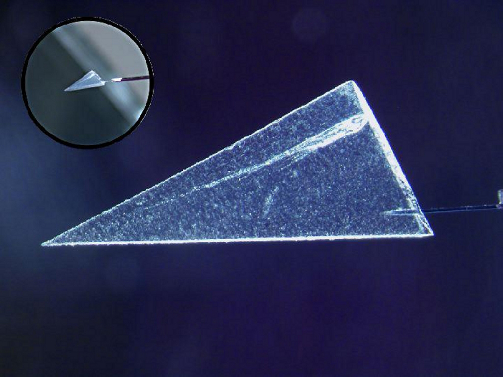 This image illustrates one of several ways scientists have begun extracting comet particles from NASA'a Stardust spacecraft's collector. First, a particle and its track are cut out of the collector material, called aerogel.