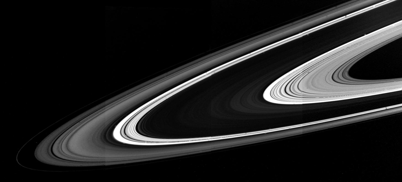 When seen from the unlit side, the rings of Saturn present a much different appearance from that familiar to telescopic observers, as shown in this image captured by NASA's Voyager 1.