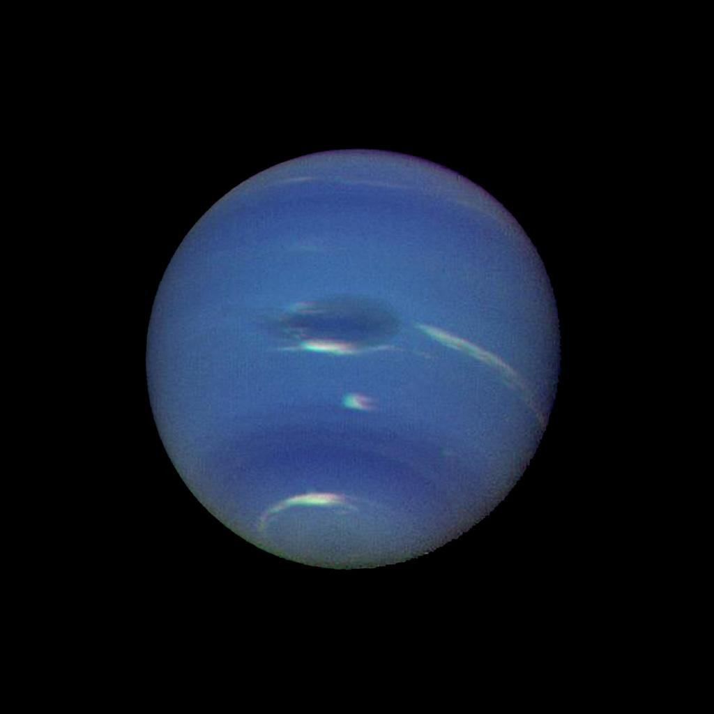 Neptune's blue-green atmosphere is shown in greater detail than ever before by NASA's Voyager 2 spacecraft as it rapidly approaches its encounter with the giant planet. This color image shows several complex and puzzling atmospheric features.