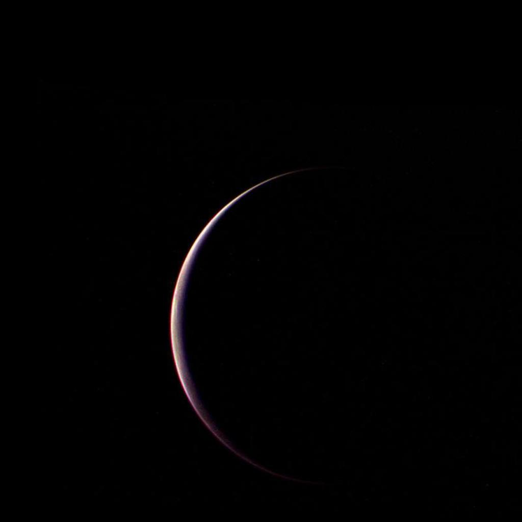 NASA's Voyager 2 obtained this parting shot of Triton, Neptune's largest satellite, shortly after closest approach to the moon and passage through its shadow on the morning of Aug. 25, 1989.