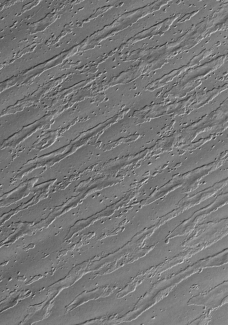 This image from NASA's Mars Global Surveyor image shows the remains of a once more laterally extensive layer overlying undulating terrain very near the south polar residual cap on Mars.