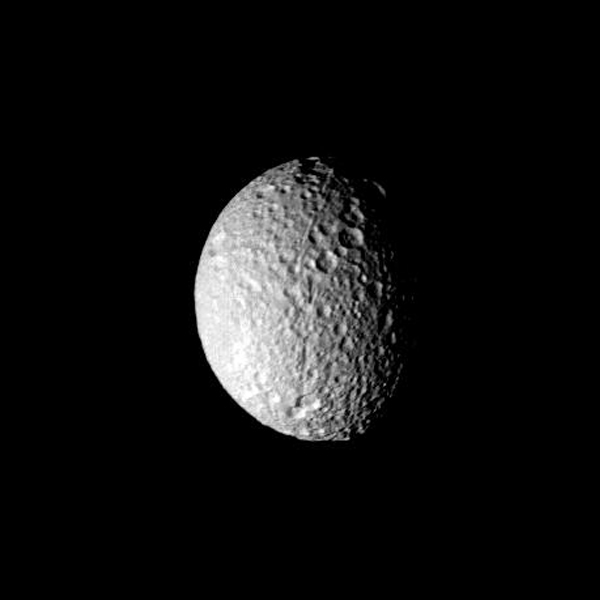This image of Saturn's moon Mimas was taken by NASA's Voyager 1 on Nov. 12, 1980 and shows the heavily and uniformly cratered surface of the satellite.