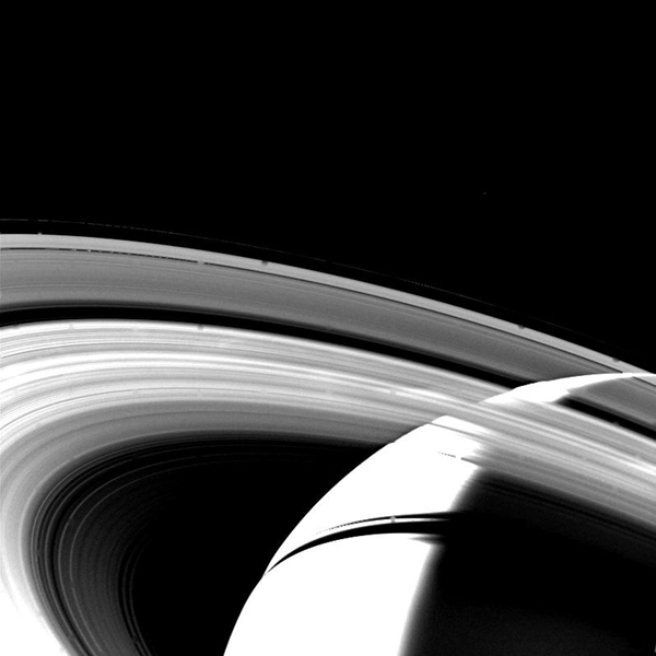 The crescent of Saturn, the planet's rings and their shadows are seen in this NASA Voyager 1 image taken Nov. 13, 1980 at a distance of 1,500,000 kilometers (930,000 miles) as the spacecraft began to leave the Saturn system.