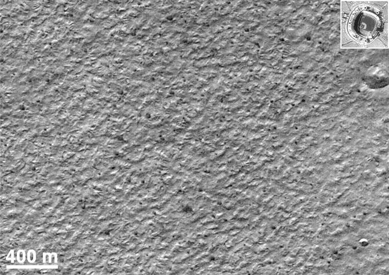 NASA's Mars Global Surveyor shows two craters, a very rare occurrence on Mars' south polar layered deposits.