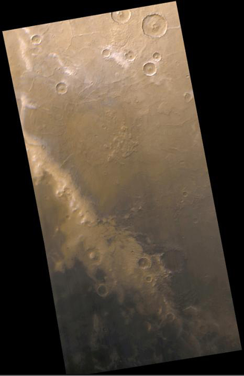 NASA's Mars Global Surveyor shows dark sand exposed from beneath retreating frost on Mars' Mountains of Mitchel.