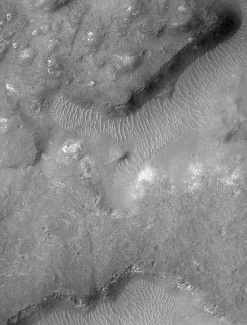 NASA's Mars Global Surveyor shows jumbled and broken terrain known as chaotic terrain. The region shown here is named 'Margaritifer Chaos.'